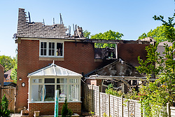 © Licensed to London News Pictures. 06/05/2020. Woolton Hill, UK. The rear of two properties show severe damage to the roof area from an overnight fire. A fire has destroyed two houses on Woolton Lodge Gardens, Woolton Hill in Hampshire. The fire started approximately 20:10 BST on Tuesday 05/05/2020. Photo credit: Peter Manning/LNP