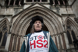 © licensed to London News Pictures. London, UK 03/12/2012. Rae Sloane, a protester against HS2 standing outside Royal Courts of Justice as groups challenge the Government's decision to go ahead with a proposed high speed rail link between London and the north of England. Photo credit: Tolga Akmen/LNP