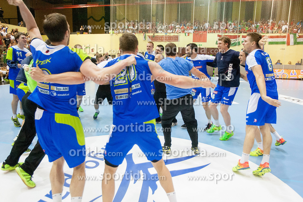 Players of team Slovenia celebrate win against Hungary after handball match between National teams of Slovenia and Hungary in play off of 2015 Men's World Championship Qualifications on June 15, 2014 in Rdeca dvorana, Velenje, Slovenia. Photo by Urban Urbanc / Sportida