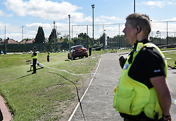 © Licensed to London News Pictures. 25/06/2017. NEWCASTLE UPON TYNE UK. Police stand guard at the scene of a fatal car crash near Westgate Sports Centre on West Road, Newcastle on 25th June 2017. A car hit worshippers leaveing Eid prayers at there are believed to be at least six people hurt in the incidentc. A 42 year old woman was arrested at the scene. Photo credit: MARY TURNER/LNP