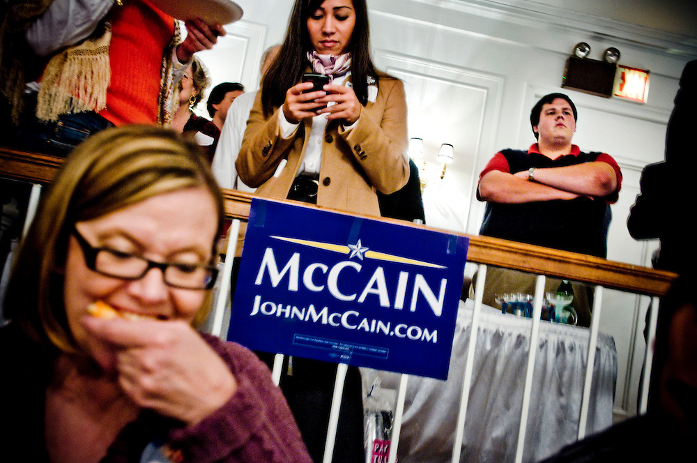 Young Republicans watching the first presidential debate between Obama and McCain at a debate watching party in the Young Republican clubhouse on Upper East Side in New York City.....In background  Bryon McKim......Photographer: Chris Maluszynski /MOMENT