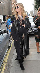 Model Abbey Clancy attends the Julien Macdonald catwalk show during London Fashion Week Spring Summer 2015 in London, UK. 13/09/2014<br /> BYLINE MUST READ : GOTCHAIMAGES.COM<br /> <br /> Copyright by © Gotcha Images Ltd. All rights reserved.<br /> Usage of this image is conditional upon the acceptance <br /> of Gotcha Images Ltd, terms and conditions available at<br /> www.gotchaimages.com