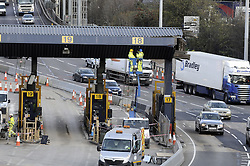© Licensed to London News Pictures. 11/12/2014 <br /> The work continues at the Dartford river crossing,Dartford,Kent to remove the tolls after the new Dart Charge came into affect at the end of last month.<br /> <br /> (Byline:Grant Falvey/LNP)