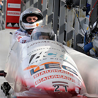 01 March 2009:    The Latvia 2 bobsled driven by Edgars Maskalans with sidepushers Ainars Podnieks and Raivis Broks, and brakeman  Reinis Rozitis finish their 4th run at the 4-Man World Championships competition on March 1 at the Olympic Sports Complex in Lake Placid, NY.   The USA 1 bobsled driven by Steven Holcomb with sidepushers Justin Olsen and Steve Mesler, and brakeman Curtis Tomasevicz won the competition and the World Championship bringing the U.S. their first world championship since 1959 with a time of 3:36.61.