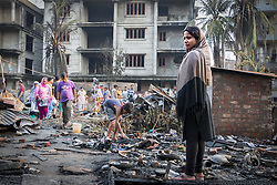 May 3, 2017 - Guwahati, Assam, India - A woman who has lost everything in yesterda's devastating fire at Ambari, Guwahati expresses her sorrow in front of her burnt down house at Ambari. A major fire broke out in Ambari area of Guwahati yesterday night, destroying around 30 shanties rendering as many families homeless. (Credit Image: © Vikramjit Kakati via ZUMA Wire)
