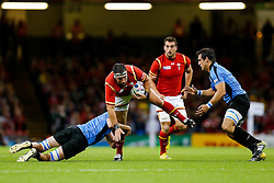 Wales Hooker Scott Baldwin is tackled by Uruguay Flanker Matias Beer - Mandatory byline: Rogan Thomson/JMP - 07966 386802 - 20/09/2015 - RUGBY UNION - Millennium Stadium - Cardiff, Wales - Wales v Uruguay - Rugby World Cup 2015 Pool A.