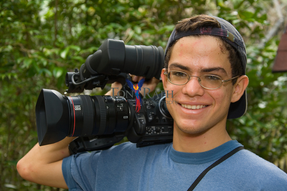 Portrait of Daniel Rath with video camera during a photo shoot at the Belize Zoo, Belize, Central America
