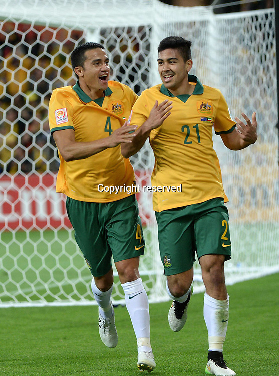 09.01.2015. Melbourne, Australia.  Massimo Luongo (R) of Australia celebrates his goal with Tim Cahill during the opening football match against Kuwait at the AFC Asian Cup in Melbourne, Australia, January 9, 2015. Australia won 4-1.