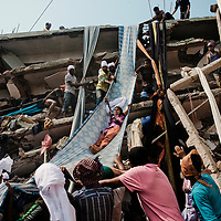 A woman worker of Rana Plaza were in the process of rescuing after 6 hours of the collapse.