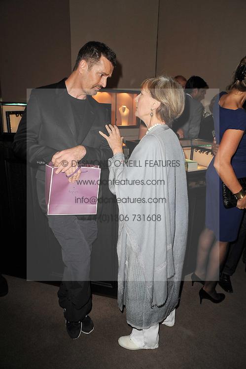 RUPERT EVERETT and PATTI PALMER-TOMKINSON at a party to celebrate the publication of Inheritance by Tara Palmer-Tomkinson at Asprey, 167 New Bond Street, London on 28th September 2010.
