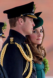 ALDERSHOT- UK -17-MAR-2014: Britain's Prince William and Kate, The Duke and Duchess of Cambridge, visit the 1st Battalion Irish Guards at the St. Patrick's Day Parade at Mons Barracks, Aldershot.<br />  <br /> The Duke of Cambridge attends the Parade as Colonel of the Regiment. The Duchess of Cambridge presented the traditional sprigs of shamrocks to the Officers and Guardsmen of the Regiment.