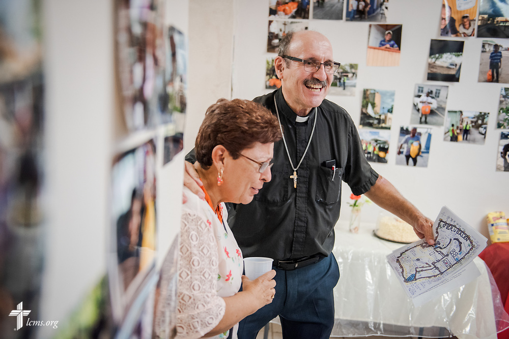 The Rev. Richard Schuller, LCMS missionary to Puerto Rico, welcomes his wife Gema Schuller, fellow missionary to Puerto Rico, during fellowship time at Fuente de Vida (Fountain of Life Lutheran Church), Ponce, Puerto Rico, on Sunday, April 15, 2018. LCMS Communications/Erik M. Lunsford
