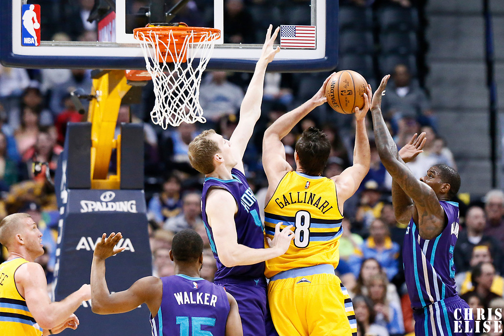 04 March 2017: Denver Nuggets forward Danilo Gallinari (8) goes for the layup against Charlotte Hornets center Cody Zeller (40) during the Charlotte Hornets 112-102 victory over the Denver Nuggets, at the Pepsi Center, Denver, Colorado, USA.