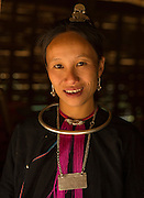 Lanten tribal woman of Ban Namkoy village in traditional wear inside her bamboo thatched hut, ,in Nam Ha National Protected Area, Luang Namtha, Northern Laos near the Chinese border