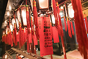 Worshippers leave messages as an offering inside the Man Mo Temple which is dedicated to the God of Literature and the God of War and was built in 1847 in Sheung Wan District of Hong Kong Island. The Taoist temple is the largest Man Mo Temple in Hong Kong and includes two additional temples for Buddhist and Taoist deities.