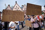 Frankfurt am Main | 26 July 2014<br /> <br /> Am Samstag (26.07.2014) demonstrierten etwa 500 Menschen auf dem R&ouml;merberg in Frankfurt am Main f&uuml;r Frieden in Pal&auml;stina / Gaza und f&uuml;r ein sofortiges Ende der israelischen Milit&auml;reins&auml;tze dort.<br /> Hier: Einige Teilnehmer der Demo f&uuml;hrten Transparente mit offen israelfeindlichen Spr&uuml;chen mit, hier z.B. &quot;Kinderm&ouml;rder Israell&quot;, &quot;Blutsauger Israel&quot; und &quot;Israel bombardiert - Merkel finanziert&quot;.<br /> <br /> &copy;peter-juelich.com<br /> <br /> FOTO HONORARPFLICHTIG!<br /> <br /> [No Model Release | No Property Release]