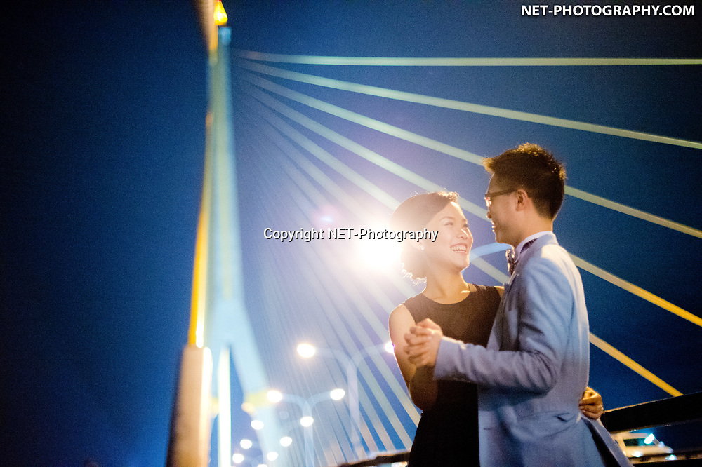 Engagement session (pre-wedding) on Rama VIII Suspension Bridge in Bangkok, Thailand.
