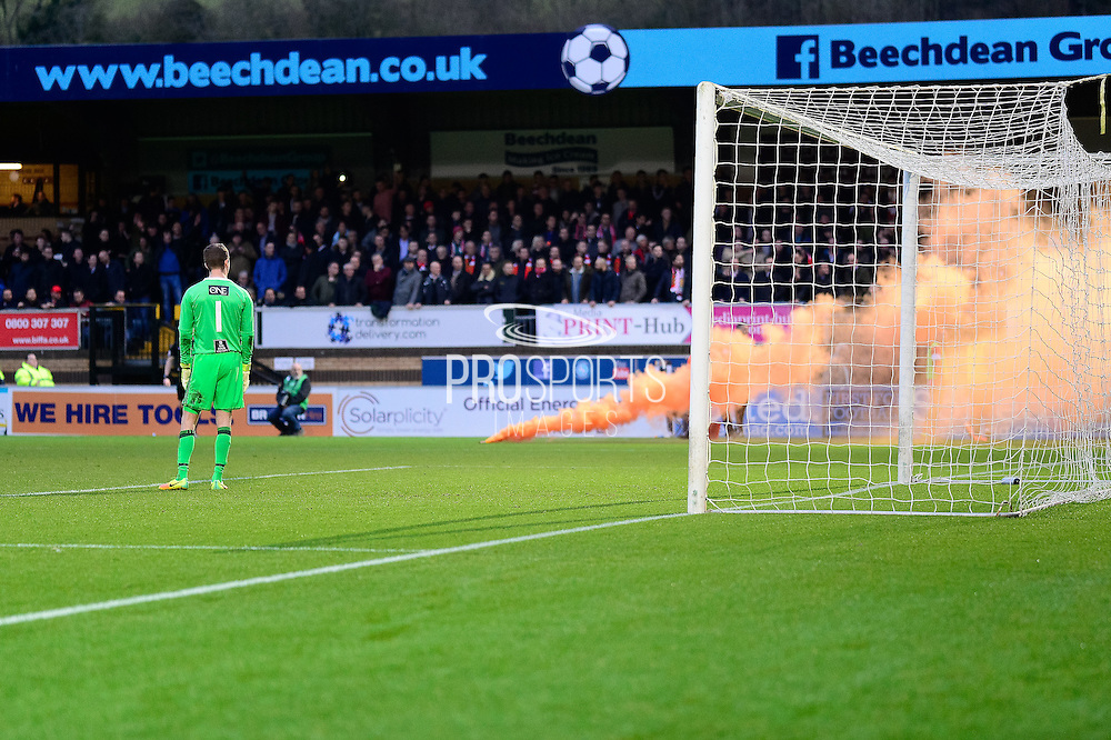 A flare is thrown onto the pitch by a Stourbridge FC fan during the The FA Cup match between Wycombe Wanderers and Stourbridge at Adams Park, High Wycombe, England on 7 January 2017. Photo by Dennis Goodwin.