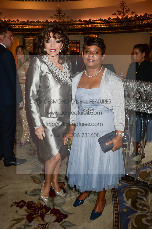 Left to right, JOAN COLLINS and BARONESS LAWRENCE OF CLARENDON at the inaugural Stephen Lawrence Memorial Ball held at The Dorchester, Park Lane, London on 17th October 2013.