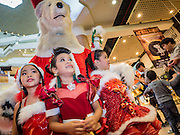 17 SEPTEMBER 2015 - BANGKOK, THAILAND:  Thai girls in Christmas outfits with the polar bear mascot for Snow Town, a theme park in Bangkok. Twenty-six Santa Clauses from around the world are in Bangkok for the first World Santa Claus Congress. The World Santa Claus Congress has been an annual event in Denmark since 1957. This year's event, hosted by Snow Town, a theme park with a winter and snow theme, hosted the event. There were Santas from Japan, Hong Kong, the US, Canada, Germany, France and Denmark. They presented gifts to Thai children and judged a Santa pageant. Thailand, a Buddhist country, does not celebrate the religious aspects of Christmas, but Thais do celebrate the commercial aspects of the holiday.   PHOTO BY JACK KURTZ