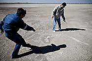 Conagua employees point out the salty nature of the soil on the bottom of the Texcoco lake bed.
