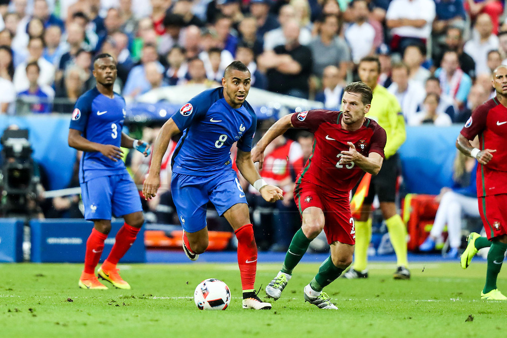 Payet and Adrien fighting for the ball during the match against that opposed France and Portugal. Portugal won the Euro Cup beating in the final home team France at Saint Denis stadium in Paris, after winning on extra-time by 1-0.