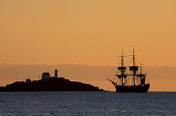 Cape Nedick Light and a replica of Captain Cook's S.S. Endeavor.  York, ME