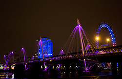 © London News Pictures. The Golden Jubilee Footbridge, central London, is illuminated pink tonight to celebrate the birth of the new royal baby, Princess of Cambridge. Isabel Infantes/LNP