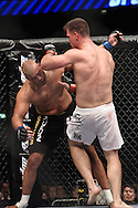 "LONDON, ENGLAND, JUNE 7, 2008: Eddie Sanchez (facing) is left unbalanced by punches from Antoni Hardonk during ""UFC 85: Bedlam"" inside the O2 Arena in Greenwich, London on June 7, 2008."