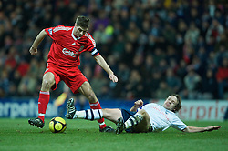 PRESTON, ENGLAND - Saturday, January 3, 2009: Liverpool's captain Steven Gerrard MBE and Preston North End's Paul McKenna during the FA Cup 3rd Round match at Deepdale. (Photo by David Rawcliffe/Propaganda)