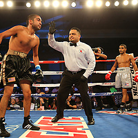 ORLANDO, FL - OCTOBER 04:  Martin Gonzales (L) is given a standing 8 count after being knocked down during a professional featherweight boxing match against Gamalier Rodriguez at the Bahía Shriners Auditorium & Events Center on October 4, 2014 in Orlando, Florida. Rodriguez won the bout by TKO. (Photo by Alex Menendez/Getty Images) *** Local Caption *** Martin Gonzales; Gamailer Rodriguez