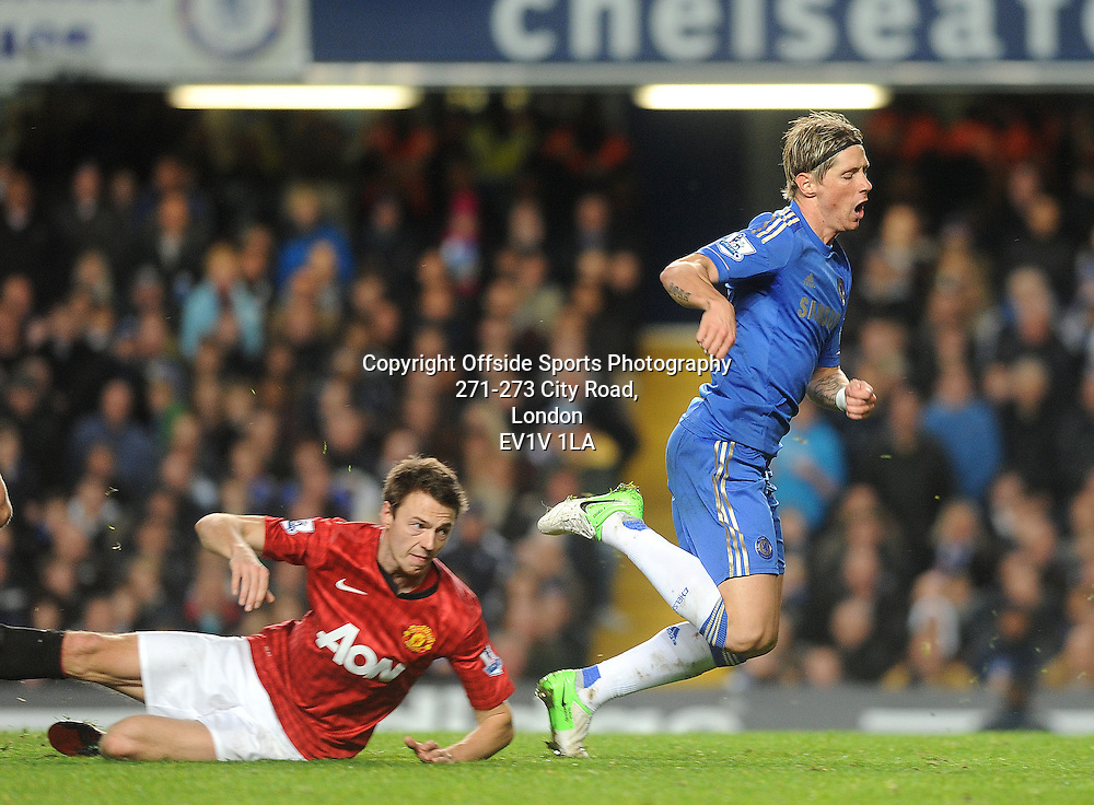 28/10/2012 - Barclays Premier League Football - 2012-2013 - Chelsea v Manchester United - Man United's Jonny Evans tackles Fernando Torres of Chelsea, Torres then gets a second yellow for Divving and is sent off. - Photo: Charlie Crowhurst / Offside.