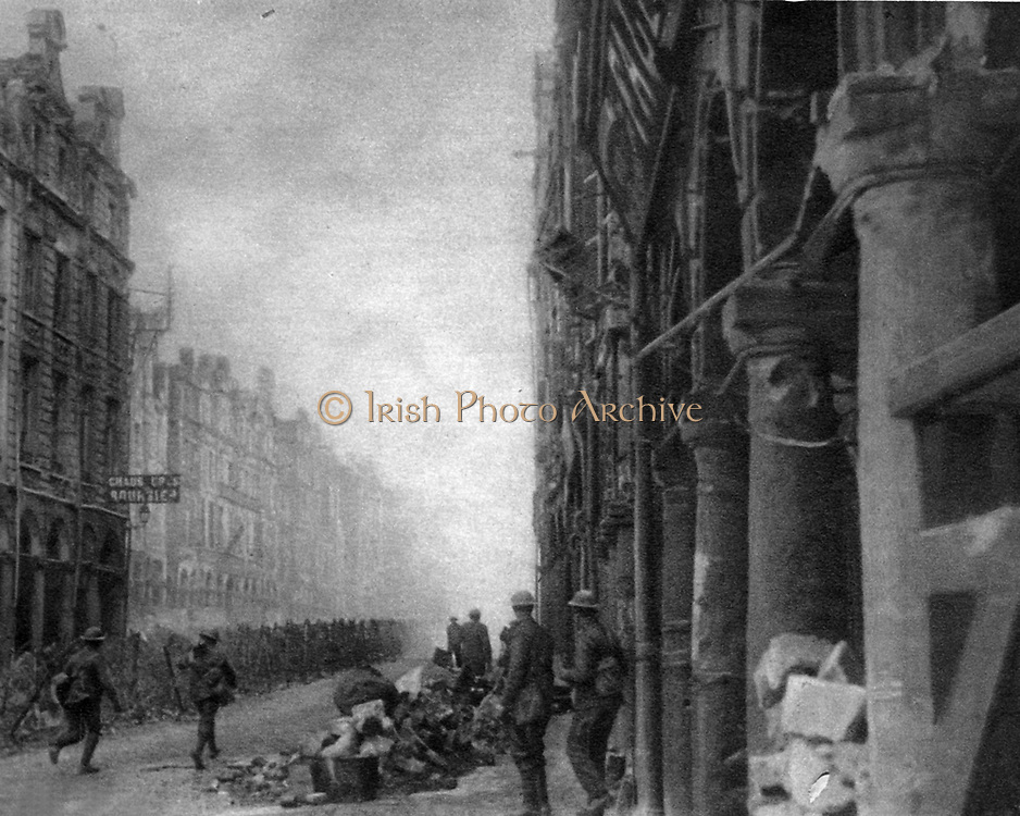British troops advance in a wire-tangled street in Arras during the great April battle. World War I