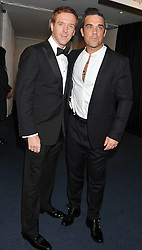Left to right, DAMIAN LEWIS and ROBBIE WILLIAMS at the GQ Men of The Year Awards 2012 held at The Royal Opera House, London on 4th September 2012.