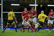 Rhys Priestland of Wales © makes a break past Kurtley Beale (10). Dove Men, autumn international test, Wales v Australia at the Millennium Stadium in Cardiff on Sat 1st Dec 2012. pic by Andrew Orchard, Andrew Orchard sports photography,