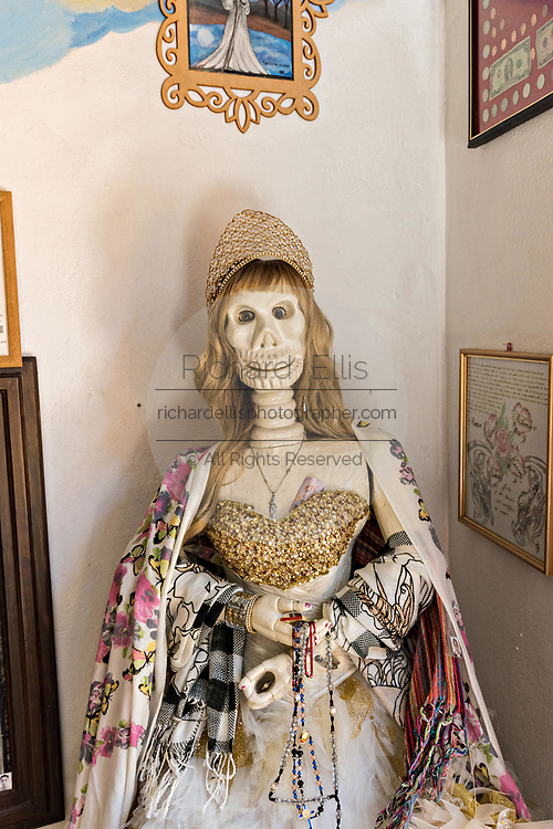 A shrine to the White Lady and offerings inside the La Casa De La Santa Muerte or House of the Saint of the Dead November 1, 2017 in Santa Ana Chapitiro, Michoacan, Mexico.