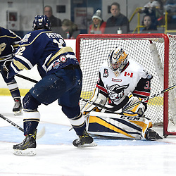 GEORGETOWN, ON  - APR 8,  2018: Ontario Junior Hockey League, South West Conference Championship Series. Game six of the best of seven series between Toronto Patriots and the Georgetown Raiders. Troy Timpano #33 of the Georgetown Raiders blocks the shot from Adam Petric #12 of the Toronto Patriots during the third period.<br /> (Photo by Andy Corneau / OJHL Images)