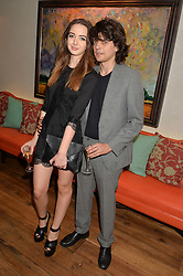 SARAH STANBURY and FENTON BAILEY at the 50th anniversary party for Daphne's restaurant, 112 Draycott Avenue, London held on 24th June 2014.