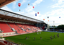 Bristol Rugby Players train in front of the new South Stand, opened to the public for the first time, as balloons from the Bristol Balloon fiesta fly over head - Mandatory byline: Joe Meredith/JMP - 07966 386802 - 07/08/2015 - RUGBY UNION - Ashton Gate Stadium - Bristol, England - South Stand Opening.