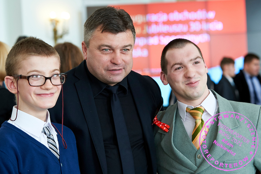 Famous former soccer player and member of parliament and Special Olympics Ambassador Roman Kosecki poses to family photo during 30 years anniversary of The Special Olympics Poland at Presidential Palace in Warsaw on March 18, 2015.<br /> <br /> Poland, Warsaw, March 18, 2015<br /> <br /> For editorial use only. Any commercial or promotional use requires permission.<br /> <br /> Mandatory credit:<br /> Photo by &copy; Adam Nurkiewicz / Mediasport