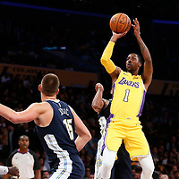02 October 2017: Los Angeles Lakers guard Kentavious Caldwell-Pope (1) goes for the jump shot over Denver Nuggets center Nikola Jokic (15) during the Denver Nuggets 113-107 victory over the LA Lakers, at the Staples Center, Los Angeles, California, USA.