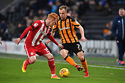 Hull City midfielder Kamil Grosicki (7) and Brentford midfielder Ryan Woods (15)  during the EFL Sky Bet Championship match between Hull City and Brentford at the KCOM Stadium, Kingston upon Hull, England on 9 December 2017. Photo by Ian Lyall.
