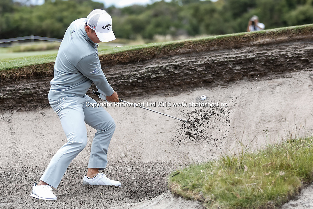 Danny Lee (NZL) plays out of the bunker during the round 1 of the World Cup of Golf at Kingston Heath Golf Club, Melbourne Australia. Thursday 24th November 2016. Copyright Photo Brendon Ratnayake / www.photosport.nz