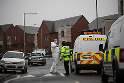 © Licensed to London News Pictures . 13/12/2015 . Bolton , UK . Police and forensic examiner at the scene . Greater Manchester Police report they are conducting a murder investigation after a man was stabbed on Brightmeadow Place in Breightmet in Bolton . Photo credit : Joel Goodman/LNP