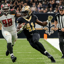 Nov 5, 2017; New Orleans, LA, USA; New Orleans Saints running back Alvin Kamara (41) runs from Tampa Bay Buccaneers defensive tackle Clinton McDonald (98) on a 33 yard touchdown during the second quarter of a game at the Mercedes-Benz Superdome. Mandatory Credit: Derick E. Hingle-USA TODAY Sports