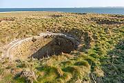 Top of old lime kilns on Holy Island, Northumberland, England, UK view south of coastline
