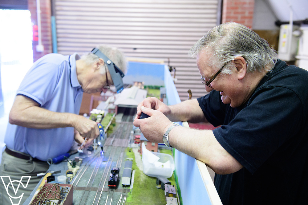 INSIGHT MAGAZINE: Bridlington Model Railway Society are based in Station Road, Bridlington, in a railway arch unit owned by Network Rail.  Pictured is Neil Porter, left, and Graham Wilson working on the model of Filey Station.<br /> <br /> Picture: Chris Vaughan Photography<br /> Date: May 31, 2017
