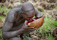 Before a Donga, some Suri warriors drink the fresh blood of their cattle during the Blood meal ritual. The warrior has to drink the entire content at one gulp as the blood coagulates quickly. Surma beleive that the cow's blood us full of vitamins that enables the warriors to be fit.