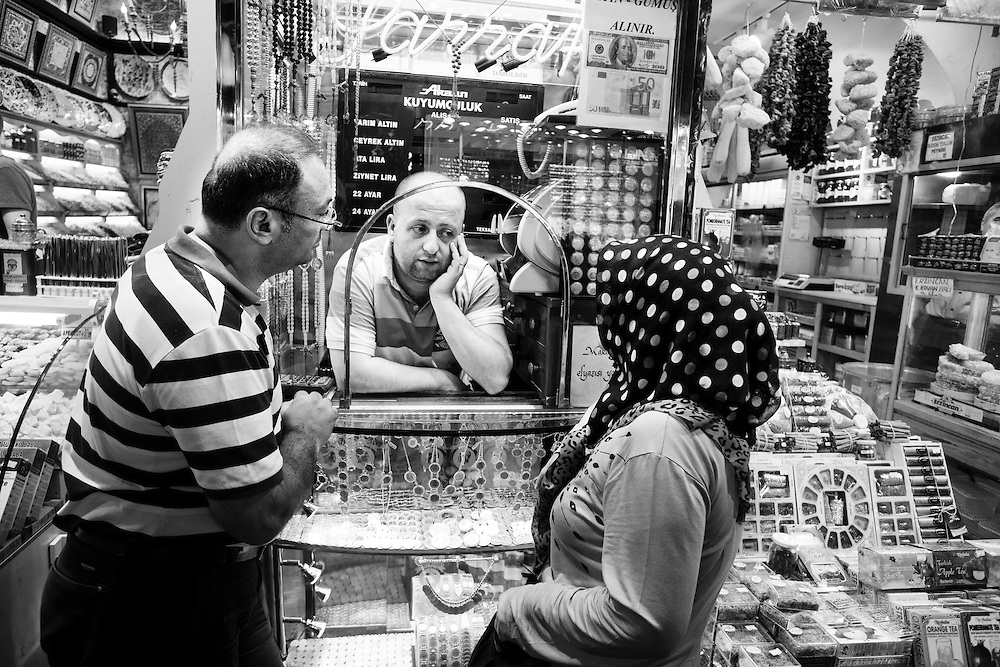 Vendor and costumers chat at the Spice Bazaar in Istanbul.