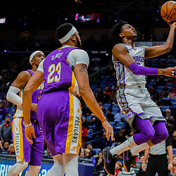 Jan 30, 2018; New Orleans, LA, USA; Sacramento Kings guard De'Aaron Fox (5) shoots over New Orleans Pelicans forward Anthony Davis (23) and forward Dante Cunningham (33) during the first quarter at the Smoothie King Center. Mandatory Credit: Derick E. Hingle-USA TODAY Sports